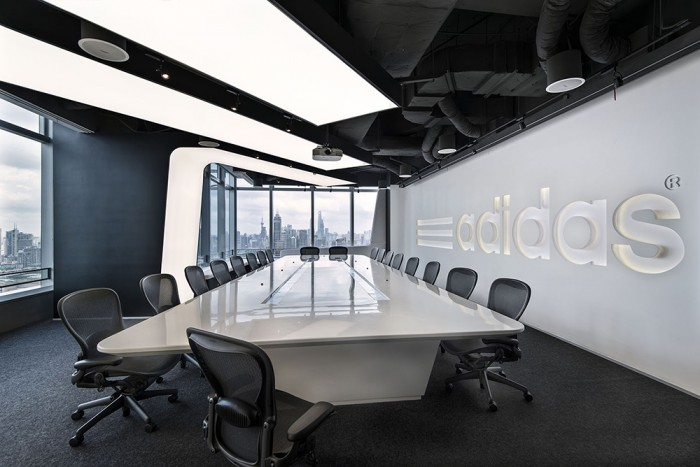 Other Rooms In The Adidas Shanghai Office Maintain Black And White Motif But Depict Images Of Athletes As Well Value Statements Decorations Are